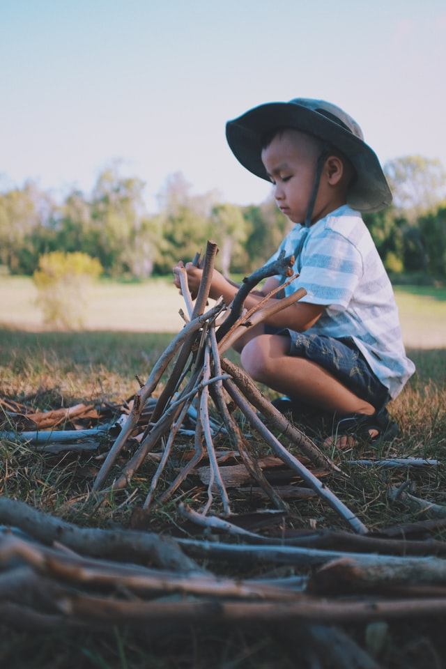 child playing loose parts play